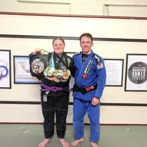 Holly Felton - Advanced Jiu Jitsu Student with her Gold Medals