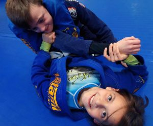 Ava triangle choking Ryder 5 Rings Jiu Jitsu Sheffield BJJ