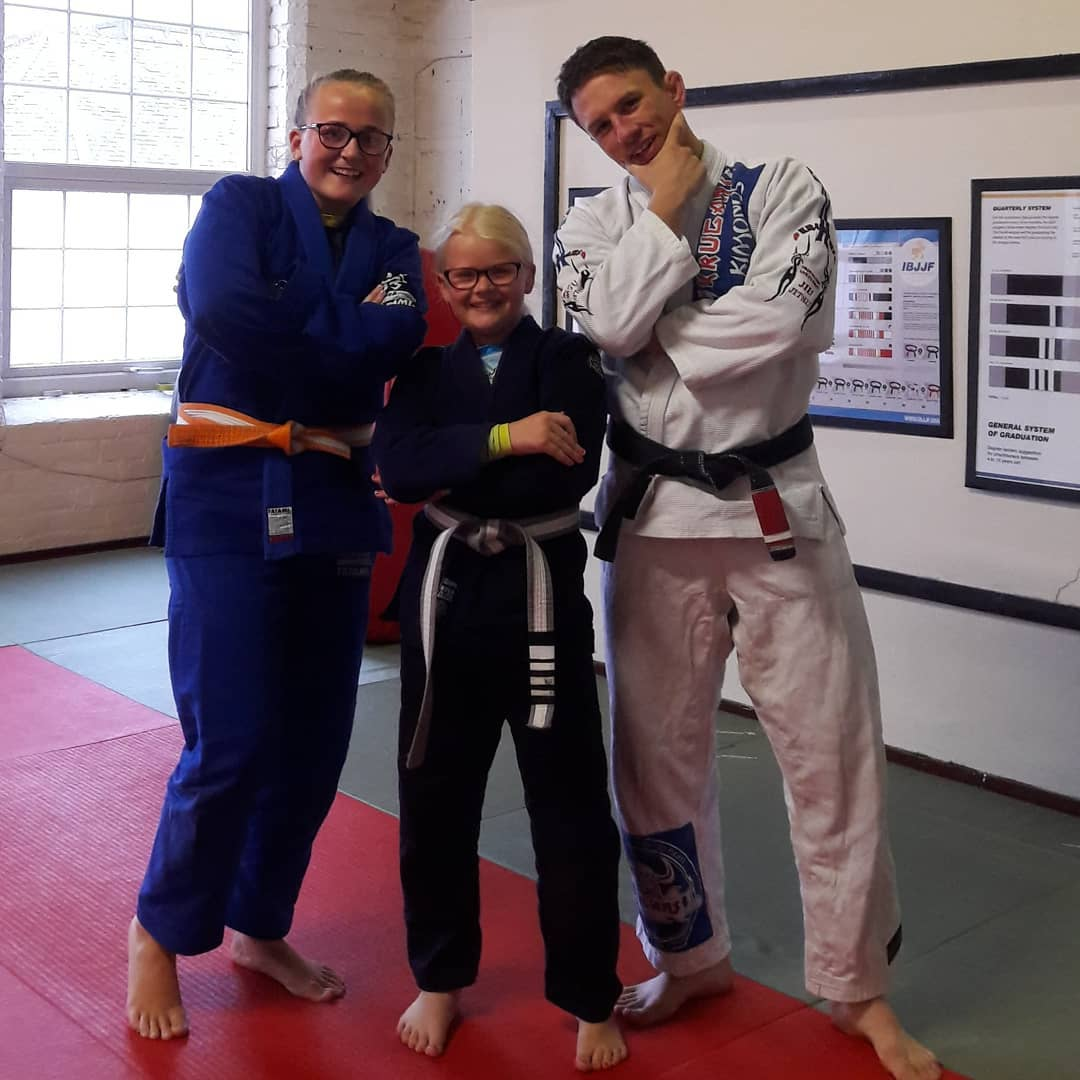 Summer, Caitlyn and Paul after a stripe promotion 5 rings bjj Mansfield